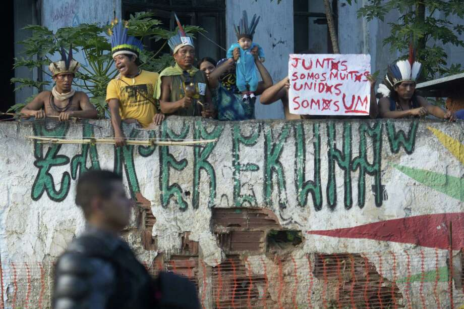 Natives protest against their eviction from the former Indigenous Museum, next to the Maracana stadium, in Rio de Janeiro, Brazil on March 21, 2013. Photo: CHRISTOPHE SIMON, AFP/Getty Images / AFP