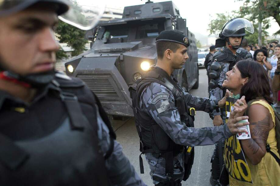 A woman argues with a riot policeman against their eviction from the former Indigenous Museum. Photo: CHRISTOPHE SIMON, AFP/Getty Images / AFP