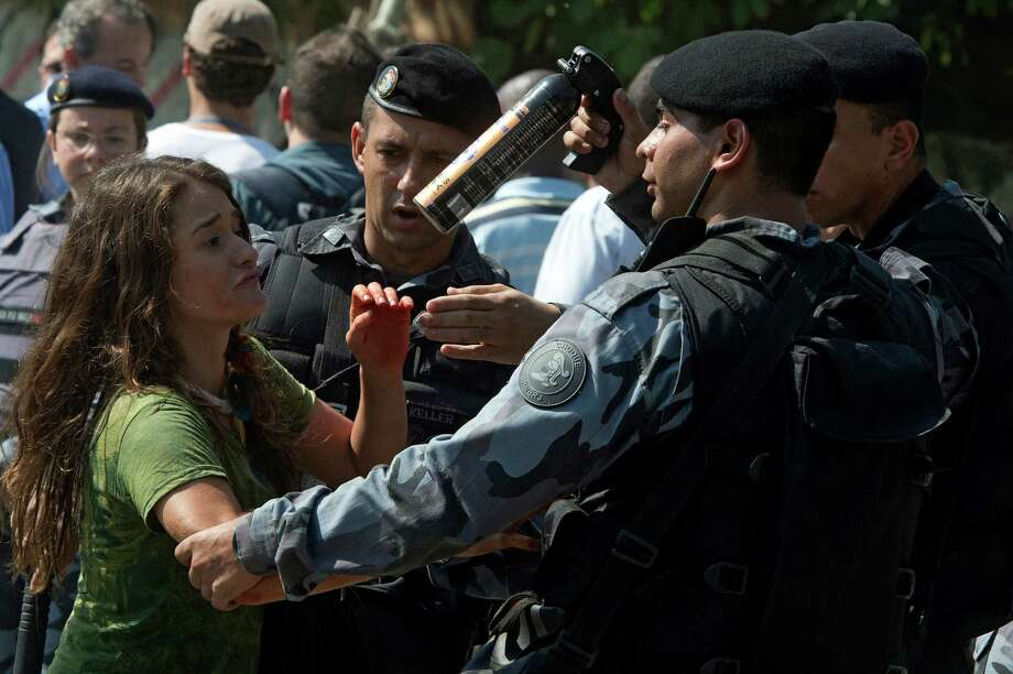 A woman is arrested as she protests against the eviction of Indigenous people. Photo: CHRISTOPHE SIMON, AFP/Getty Images / Christophe Simon