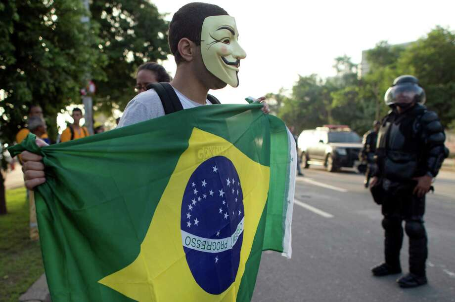 A man wearing a Guy Fawkes mask used by the Anonymous movement, protest against the eviction of natives from the former Indigenous Museum, next to the Maracana stadium, in Rio de Janeiro, Brazil on March 21, 2013.  Photo: CHRISTOPHE SIMON, AFP/Getty Images / Christophe Simon