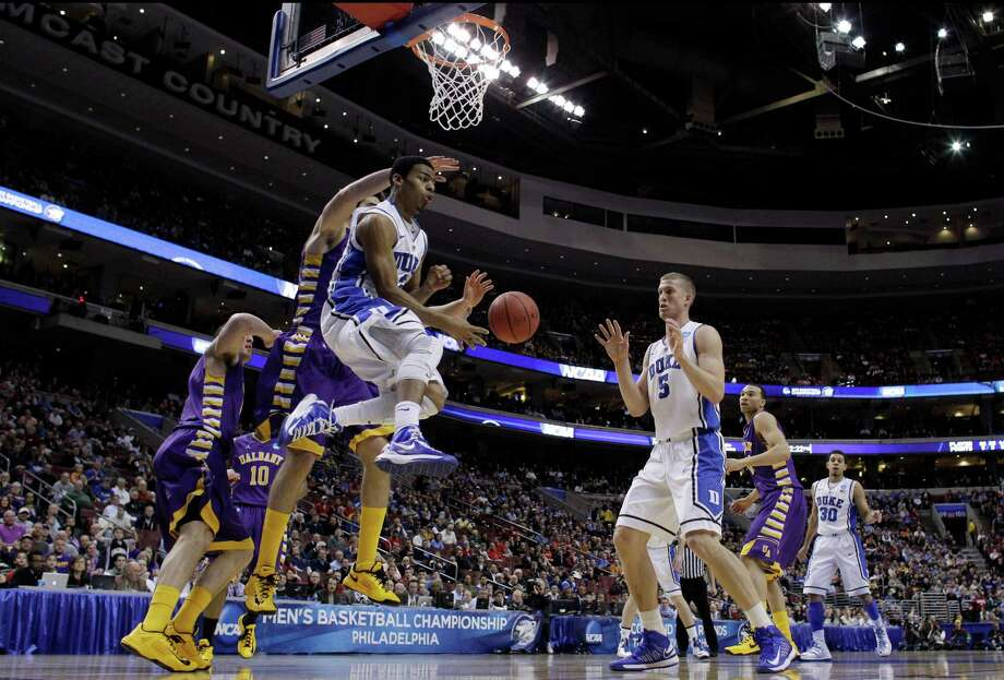 Duke's Quinn Cook, center, passes the ball to Mason Plumlee, right, as Albany's Sam Rowley, left, defends during the first half of a second-round game of the NCAA college basketball tournament, Friday, March 22, 2013, in Philadelphia. Photo: Matt Slocum, AP / AP