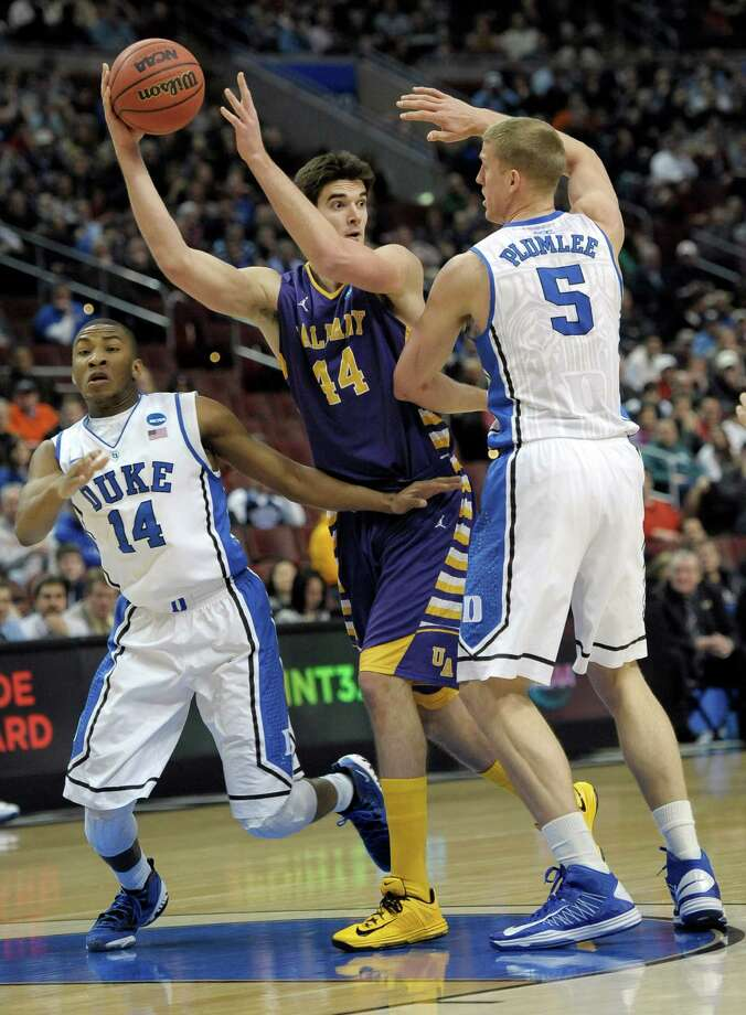 Albany's John Puk, center, tries to pass the ball under pressure from Duke's Rasheed Sulaimon, left, and Mason Plumlee during the first half of a second-round game of the NCAA college basketball tournament, Friday, March 22, 2013, in Philadelphia. Photo: Michael Perez, AP / FR168006 AP