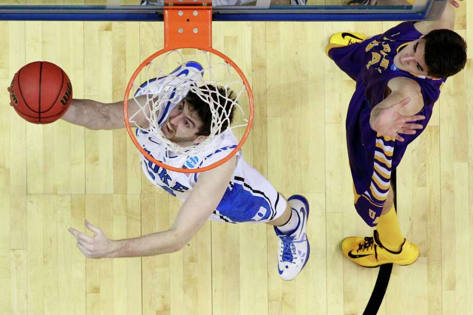 Duke's Ryan Kelly, left, goes up for a shot as Albany's John Puk defends during the first half of a second-round game of the NCAA college basketball tournament, Friday, March 22, 2013, in Philadelphia. Photo: Matt Slocum, AP / AP
