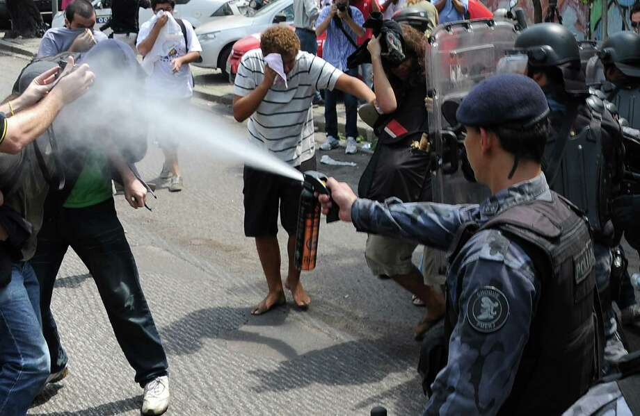 A riot policeman use tear gas against demonstrators Friday, March 22. Photo: VANDERLEI ALMEIDA, AFP/Getty Images / AFP