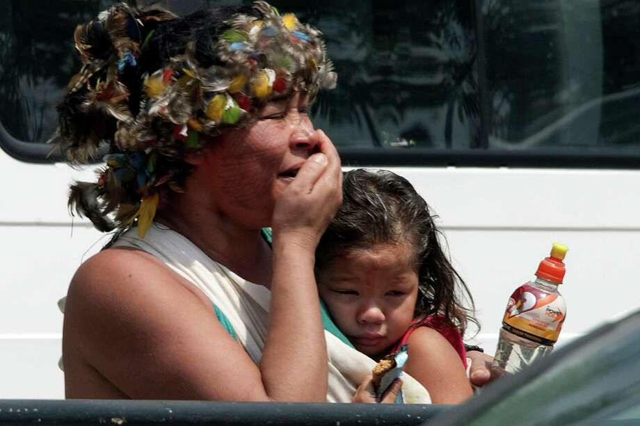 A native woman and her daughter cry during their eviction by riot police forces, outside the former Indigenous Museum. Photo: VANDERLEI ALMEIDA, AFP/Getty Images / VANDERLEI ALMEIDA
