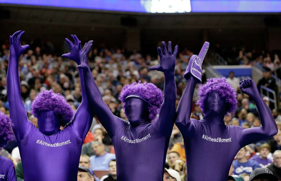 PHILADELPHIA, PA - MARCH 22:  Albany Great Danes fans cheer on their team in the first half while taking on the Duke Blue Devils during the second round of the 2013 NCAA Men's Basketball Tournament on March 22, 2013 at Wells Fargo Center in Philadelphia, Pennsylvania. Photo: Rob Carr, Getty Images / 2013 Getty Images