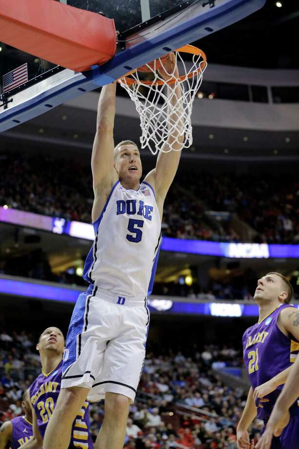 Duke's Mason Plumlee, center, dunks the ball as Albany's Gary Johnson, left, and Blake Metcalf look on during the first half of a second-round game of the NCAA college basketball tournament, Friday, March 22, 2013, in Philadelphia. Photo: Matt Slocum, AP / AP