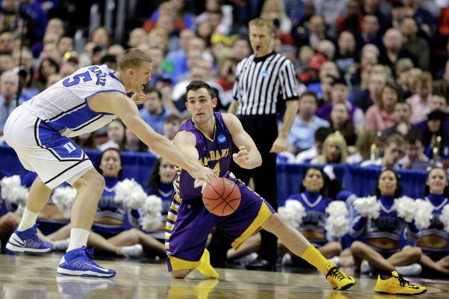 Albany's Sam Rowley, right, tries to pass the ball past Duke's Mason Plumlee during the first half of a second-round game of the NCAA college basketball tournament, Friday, March 22, 2013, in Philadelphia. Photo: Matt Slocum, AP / AP