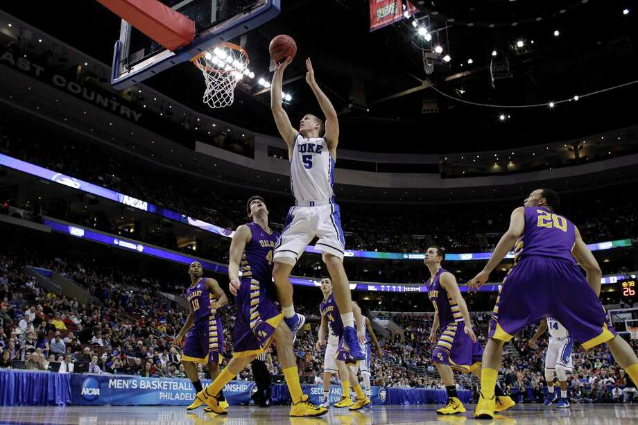 Duke's Mason Plumlee (5) goes up for a shot against Albany's John Puk (44) during the first half of a second-round game of the NCAA college basketball tournament, Friday, March 22, 2013, in Philadelphia. Photo: Matt Slocum, AP / AP