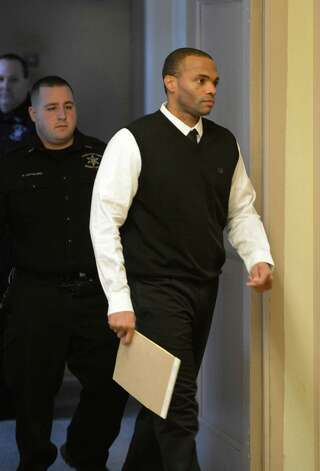 James Wells enters the court room in the Schenectady County Courthouse this morning Feb. 7, 2013, in Schenectady, N.Y.  for his trial for the shooting death of Schenectady High School basketball standout, Eddie Stanley, during a June 2011 house party. (Skip Dickstein/Times Union) Photo: SKIP DICKSTEIN / 00021071Aa