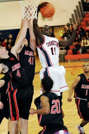 Schenectady's Eddie Stanley (11), right, grabs the rebound during a basketball game against Albany Academy on Friday, Jan. 14, 2011, at Schenectady High in Schenectady, N.Y. Stanley was identified as the Schenectady teen who was shot and killed early Sunday, June 12, 2011, in that city. (Cindy Schultz/Times Union archive) Photo: Cindy Schultz / 00011701A