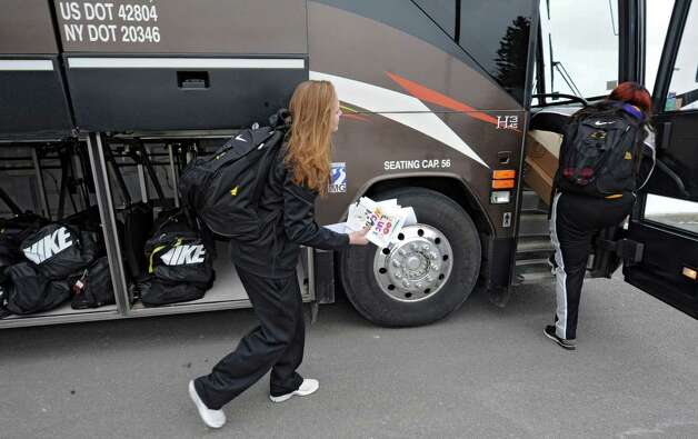 UAlbany basketball player Sarah Royals carries good luck cards handmade by children as UAlbany women's basketball team departs from the SEFCU arena for the NCAA Tournament held in Delaware on Friday, March 22, 2013 in Albany, N.Y. (Lori Van Buren / Times Union) Photo: Lori Van Buren
