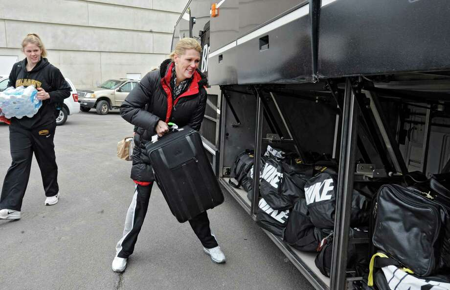 Head coach Katie Abrahamson-Henderson throws her luggage on to the bus as the UAlbany women's basketball team departs for the NCAA Tournament held in Delaware on Friday, March 22, 2013 in Albany, N.Y. (Lori Van Buren / Times Union) Photo: Lori Van Buren