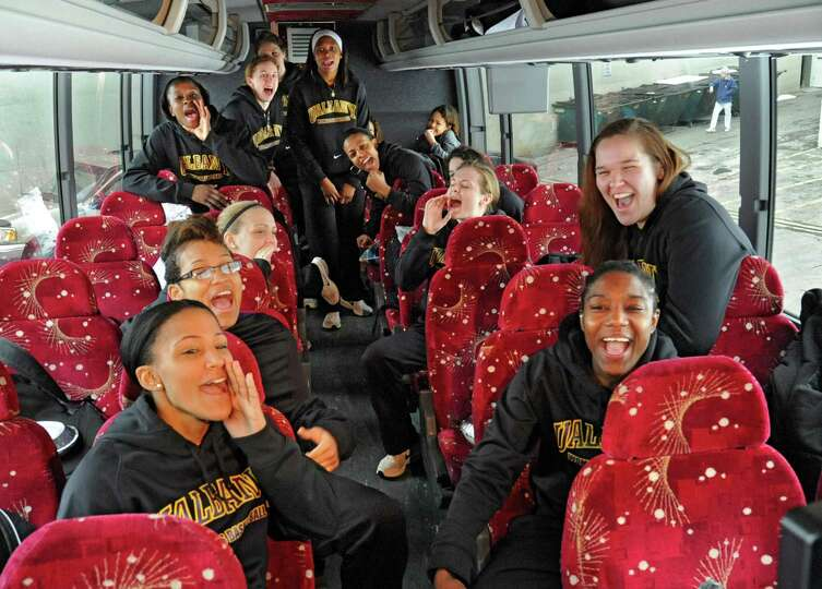 Members of the UAlbany women's basketball team show their enthusiasm as they depart from the SEFCU a