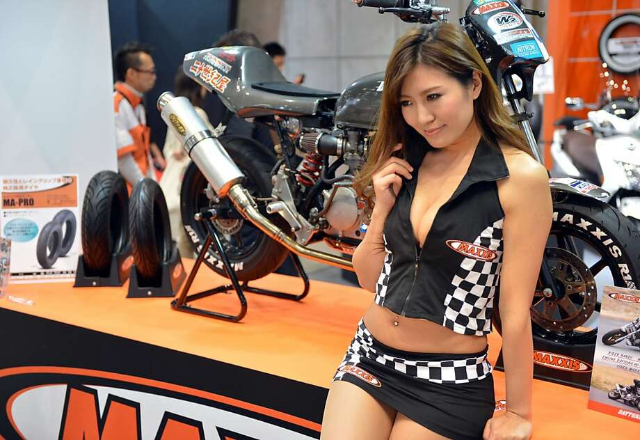Ma'am, if you don't mind, we're trying to look at those Taiwanese Maxxis:The problem with the Tokyo Motorcycle Show is that the models keep blocking the view of the latest bikes and motorcycle parts. So annoying. Photo: Yoshikazu Tsuno, AFP/Getty Images