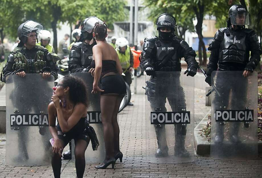 What college did you say you attend, ladies?University students dance suggestively for riot police during a protest in Medellin, Colombia, against government plans to partially privatize public universities. Photo: Raul Arboleda, AFP/Getty Images