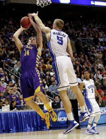 Sam Rowley #14 of the Albany Great Danes shoots over Mason Plumlee #5 of the Duke Blue Devils in the