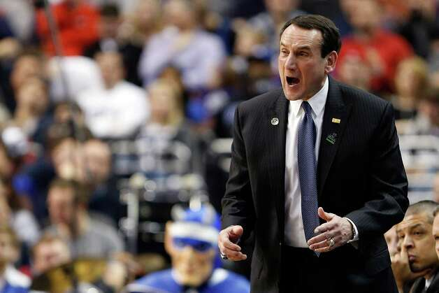 Head coach Mike Krzyzewski of the Duke Blue Devils calls out in the first half while taking on the Albany Great Danes. Photo: Rob Carr, Getty Images / 2013 Getty Images