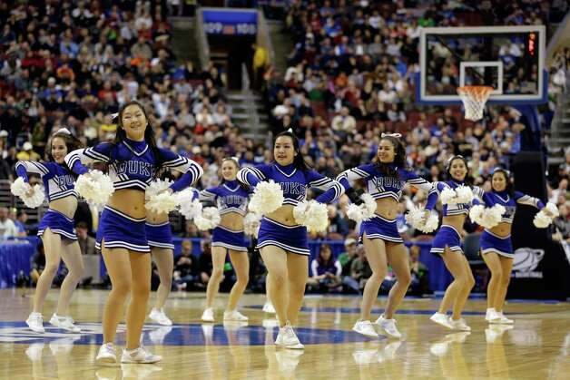 The Duke Blue Devils cheerleaders perform during a break in the game against the Albany Great Danes. Photo: Rob Carr, Getty Images / 2013 Getty Images