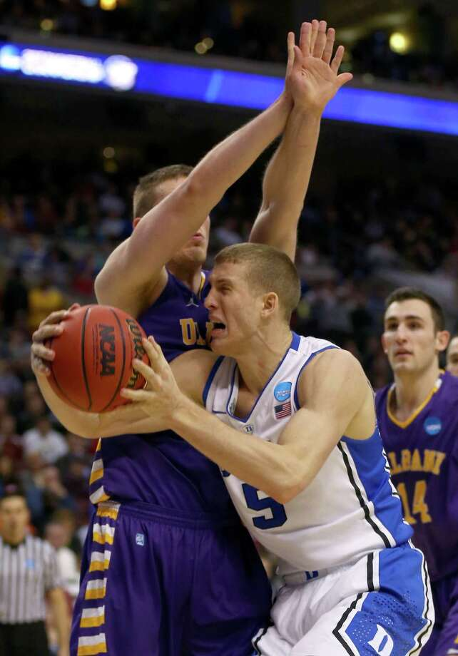 Mason Plumlee #5 of the Duke Blue Devils goes up for a shot against Luke Devlin #11 of the Albany Great Danes. Photo: Elsa, Getty Images / 2013 Getty Images