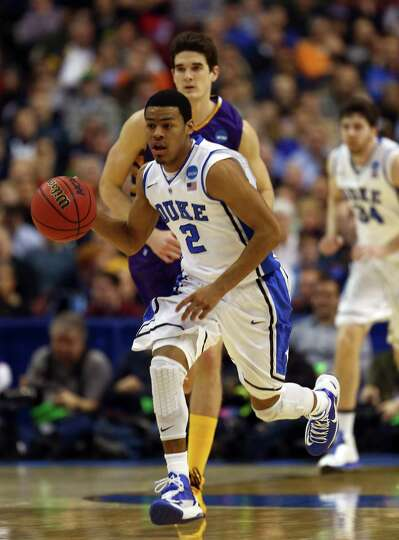 Quinn Cook #2 of the Duke Blue Devils moves the ball upcourt in front of John Puk #44 of the Albany
