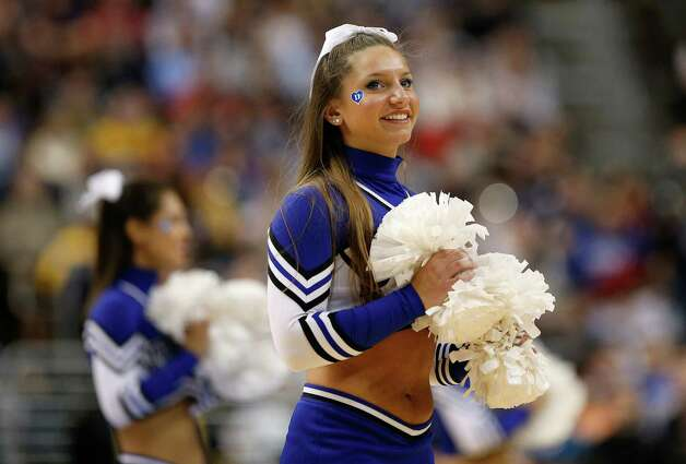 A Duke Blue Devils cheerleader performs in the first half while taking on the Albany Great Danes. Photo: Rob Carr, Getty Images / 2013 Getty Images