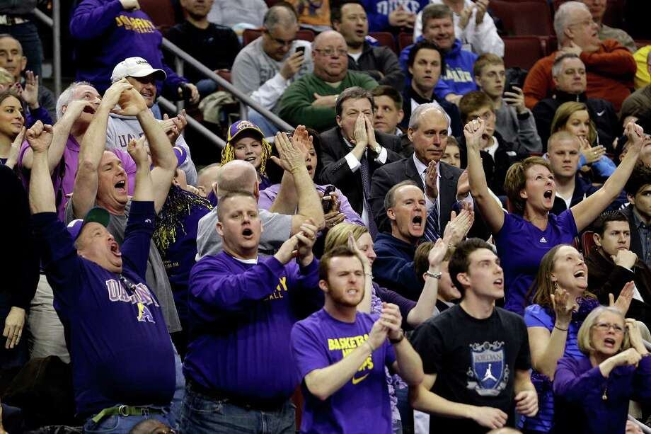 PHILADELPHIA, PA - MARCH 22:  Albany Great Danes fans cheer on their team in the second half while taking on the Duke Blue Devils during the second round of the 2013 NCAA Men's Basketball Tournament on March 22, 2013 at Wells Fargo Center in Philadelphia, Pennsylvania. Photo: Rob Carr, Getty Images / 2013 Getty Images