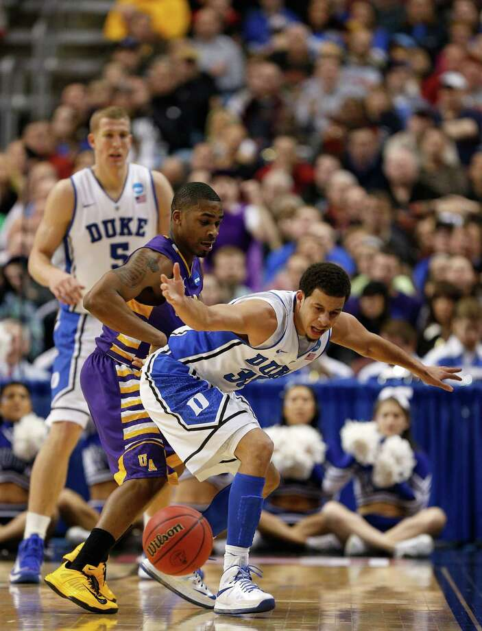 PHILADELPHIA, PA - MARCH 22:  Seth Curry #30 of the Duke Blue Devils and Mike Black #10 of the Albany Great Danes go after a loose ball in the second half during the second round of the 2013 NCAA Men's Basketball Tournament on March 22, 2013 at Wells Fargo Center in Philadelphia, Pennsylvania. Photo: Rob Carr, Getty Images / 2013 Getty Images