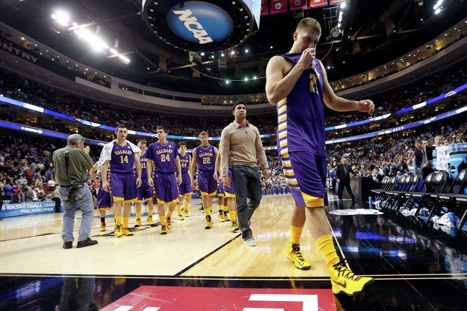 PHILADELPHIA, PA - MARCH 22:  Blake Metcalf #21 of the Albany Great Danes walks off the court after losing to the Duke Blue Devils 73-61 in the second round of the 2013 NCAA Men's Basketball Tournament on March 22, 2013 at Wells Fargo Center in Philadelphia, Pennsylvania. Photo: Rob Carr, Getty Images / 2013 Getty Images