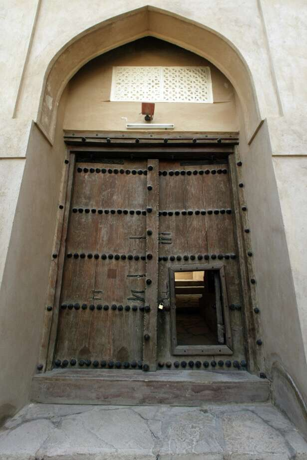 The entrance to Rustaq Fort has heavy, reinforced doors, one with a smaller door for quick entry.
