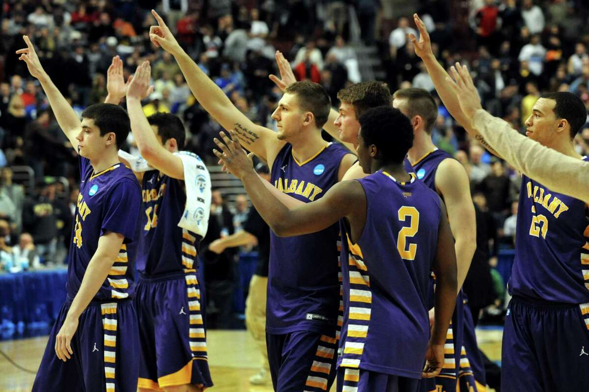 UAlbany's basketball team salutes their fans when they lose 73-61 to Duke in the second round NCAA Tournament on Friday, March 22, 2013, at Wells Fargo Center in Philadelphia, Penn. (Cindy Schultz / Times Union)