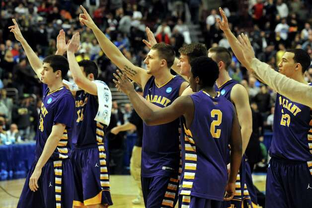 UAlbany's basketball team salutes their fans when they lose 73-61 to Duke in the second round NCAA Tournament on Friday, March 22, 2013, at Wells Fargo Center in Philadelphia, Penn. (Cindy Schultz / Times Union) Photo: Cin