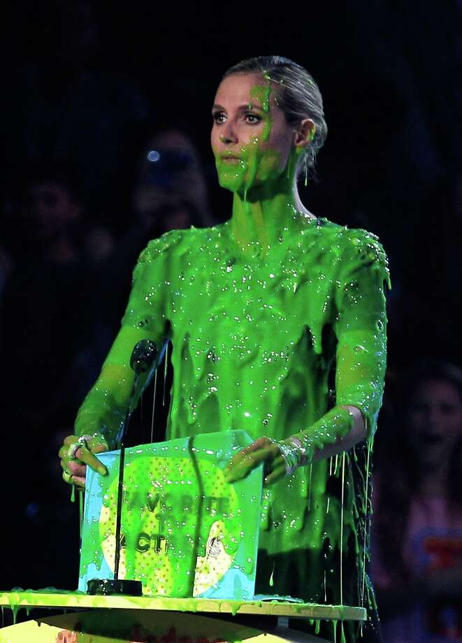 Supermodel Heidi Klum gets slimed onstage during Nickelodeon's 24th Annual Kids' Choice Awards in 2011. Photo: Christopher Polk/KCA2011 / 2011 Christopher Polk/KCA2011