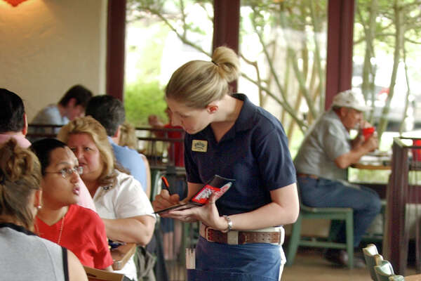 Kim Arispe takes a lunch order Tuesday May 18, 2004 at Alamo Cafe of 281 in San Antonio. KEVIN GEIL/STAFF