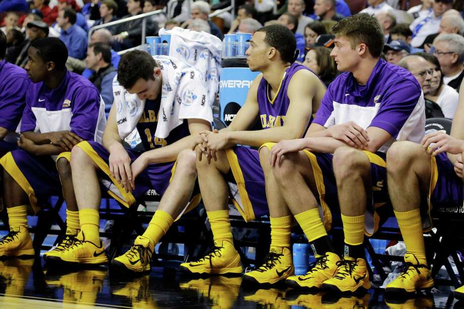 Albany's Sam Rowley (14) reacts on the bench with teammates during the final minute of the second half of a second-round game against Duke in the NCAA college basketball tournament, Friday, March 22, 2013, in Philadelphia. Duke won 73-61. Photo: Matt Slocum, AP / AP