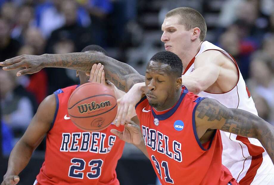 Mississippi Rebels forward Murphy Holloway (31) stripped the ball from Wisconsin Badgers forward/center Jared Berggren (40) in the second half during NCAA second-round men's basketball tournament action on Friday, March 22, 2013, at the Sprint Center in Kansas City, Missouri. Ole Miss won 57-46. (David Eulitt/Kansas City Star/MCT) Photo: David Eulitt, McClatchy-Tribune News Service / Kansas City Star
