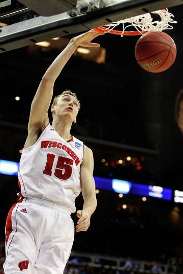 Sam Dekker #15 of the Wisconsin Badgers shoots against the Ole Miss Rebels in the second half during