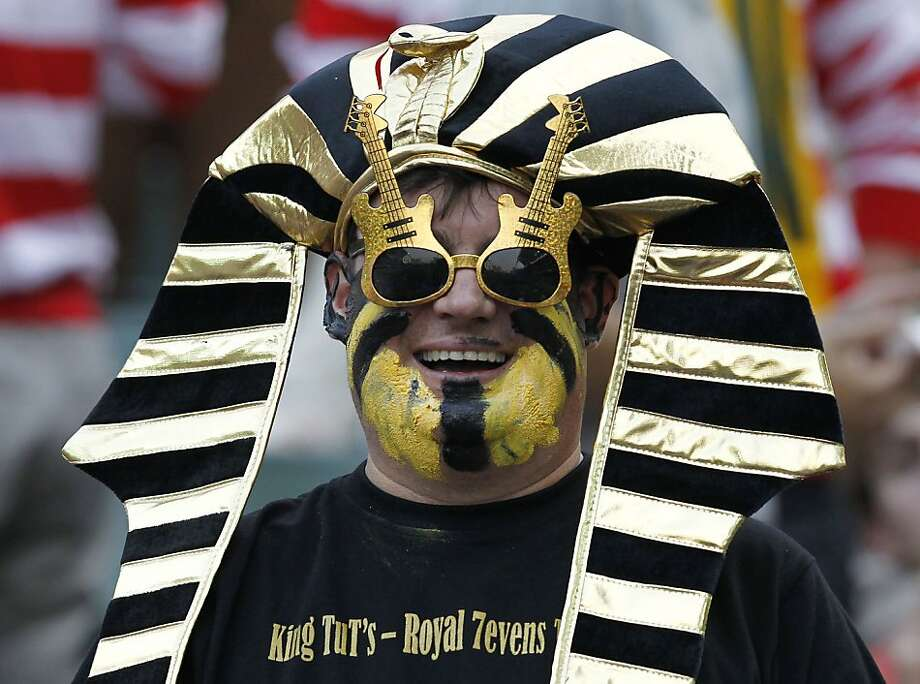 Guitar pharaoh:King Tut attends a Rugby Sevens tournament in Hong Kong. Photo: Vincent Yu, Associated Press