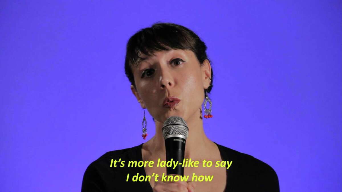 """A still from a Julia Landois Barbosa video that is part of the exhibit """"Bite Like a Kitty."""""""