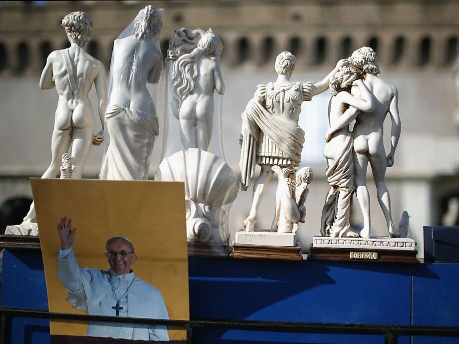 Papal paraphernalia:A souvenir stand in Rome offers postcards of the new pontiff as well as a wide selection of classical butt statuettes. Photo: Christopher Furlong, Getty Images