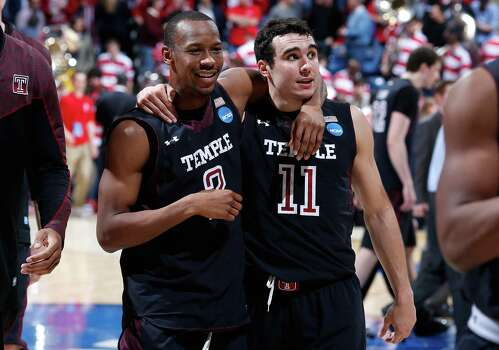 Will Cummings #2 and T.J. DiLeo #11 of the Temple Owls walk off the court after defeating the North Carolina State Wolfpack. Photo: Joe Robbins, Getty Imag