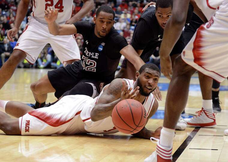 Richard Howell #1 of the North Carolina State Wolfpack tries to pass a loose ball against Rahlir Hol