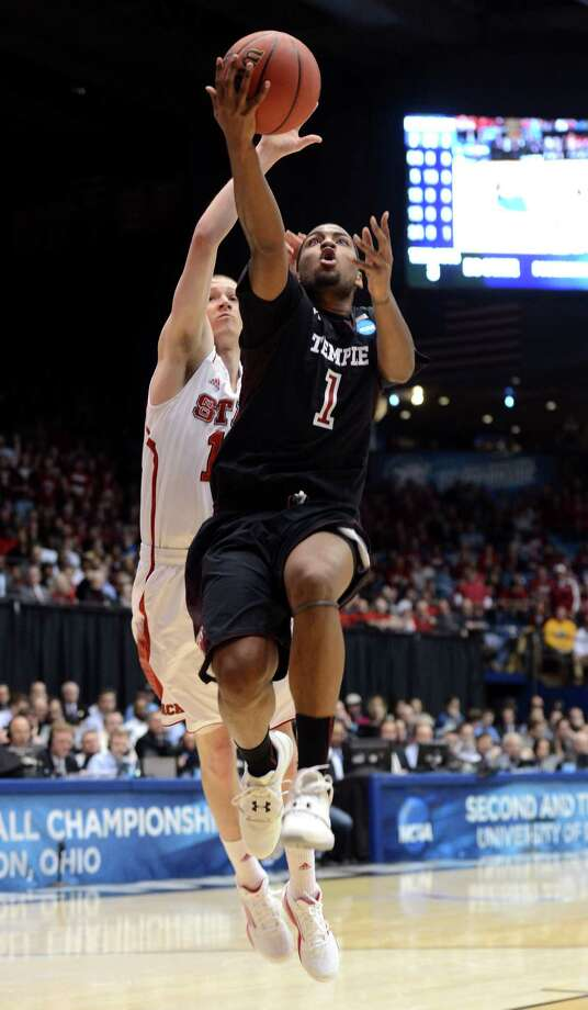 Khalif Wyatt #1 of the Temple Owls drives to the basket against Scott Wood #15 of the North Carolina State Wolfpack in the second half. Photo: Jason Miller, Getty Images / 2013 Getty Images