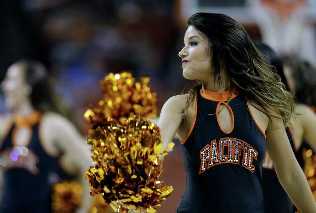 A Pacific cheerleader during the first half of a second-round game of the NCAA college basketball tournament against the Miami Friday, March 22, 2013, in Austin, Texas.  (AP Photo/David J. Phillip) Photo: David J. Phillip, Associated Press / AP
