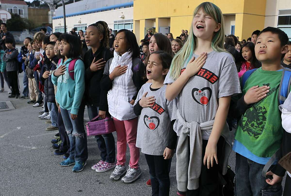 Students in Patricia Juri's 4th-grade class recite the Pledge of Allegiance during a bi-weekly assembly at Argonne Elementary School in San Francisco, Calif. on Friday, March 15, 2013.