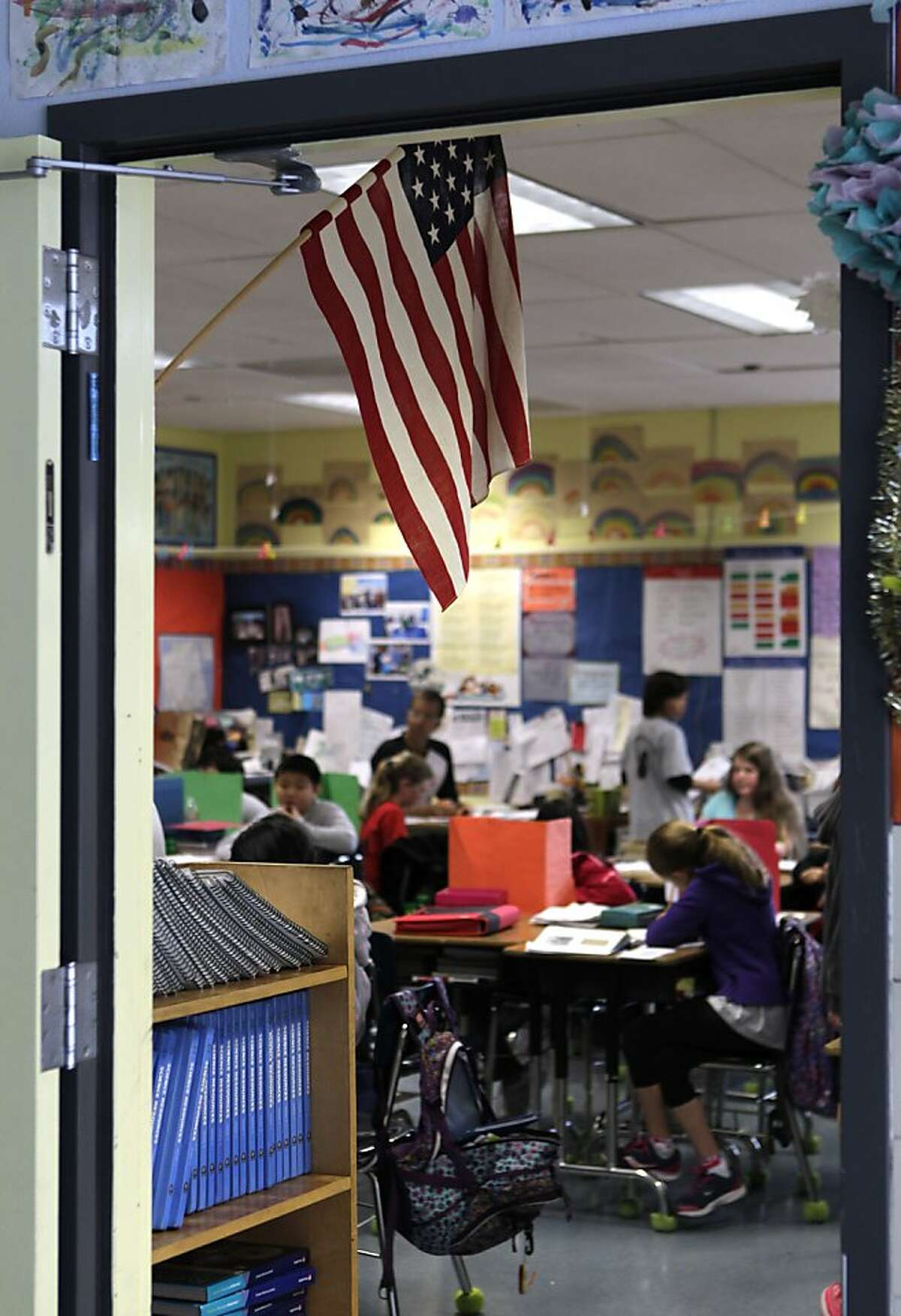 The U.S. flag hangs in David Allyn's 5th-grade classroom at Argonne Elementary School in San Francisco, Calif. on Friday, March 15, 2013. Students at Argonne recite the Pledge of Allegiance during bi-weekly assemblies on the schoolyard.