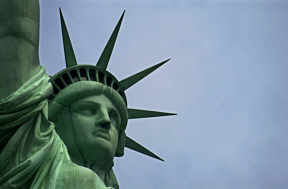 The Statue of Liberty stands in New York Harbor in New York. A reader writes that granting citizenship to people who have entered the country illegally goes against America's foundation of freedom. Photo: Express-News File Photo
