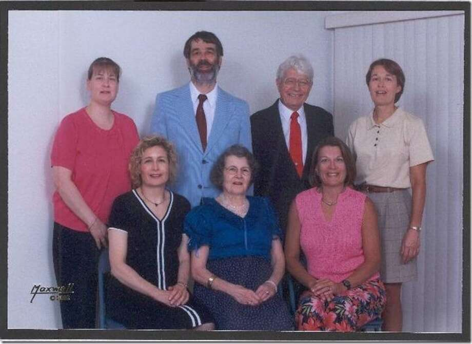 Now:Twenty-six years after taking a similar portrait, the Bock family decided to re-create it in Denver. They are (front row, from left) Bonnie, mom Virginia and Brenda and (back row), Sheri, George Bock II, dad George and Melanie. Young George even wore the same powder-blue jacket as in the original, according to his sister Sheri, who live in San Antonio. Virginia Bock died four years ago, while George Bock recently celebrated his 98th birthday. Photo: Bock, Reader Submission