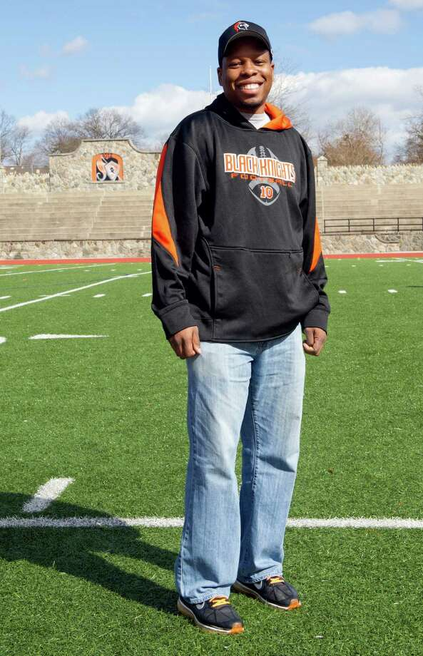 Jamar Greene, football coach at Stamford High School, poses for a photo at Boyle Stadium on Friday, March 22, 2013. Photo: Lindsay Perry / Stamford Advocate
