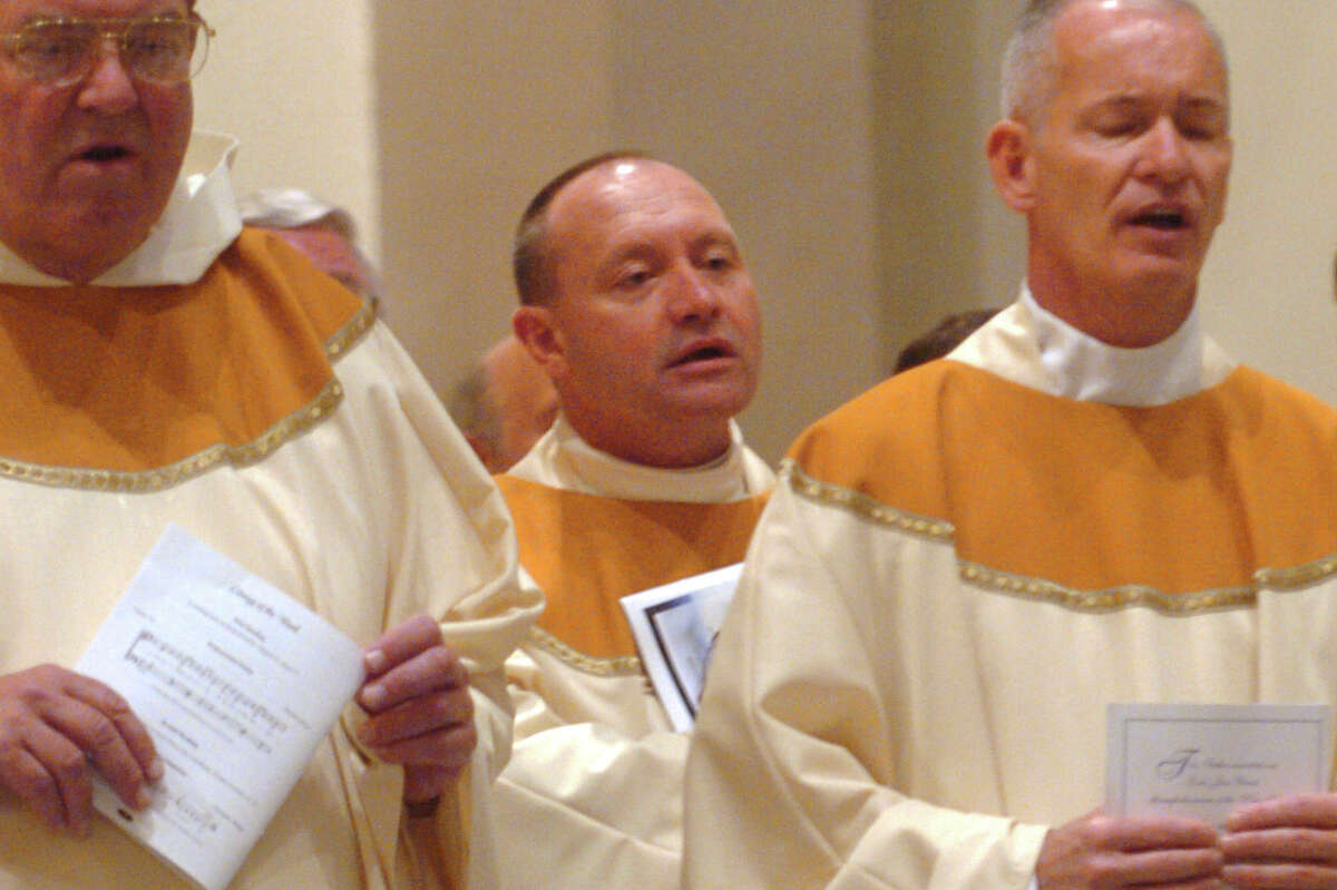 Monsignor Kevin Wallin (center) and other priest take part in an Ordination service for new priests at St. Augustine Cathederal, in Bridgeport, Conn. May 21st, 2013.
